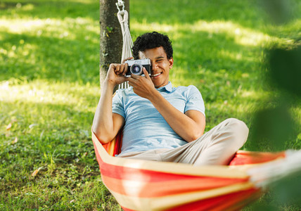 Young man relaxing on hammock