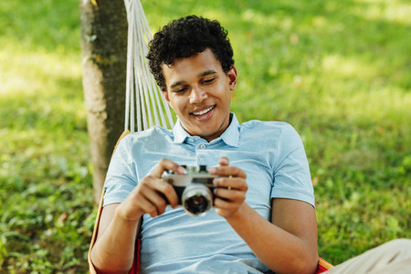 Young smiling man holding a film