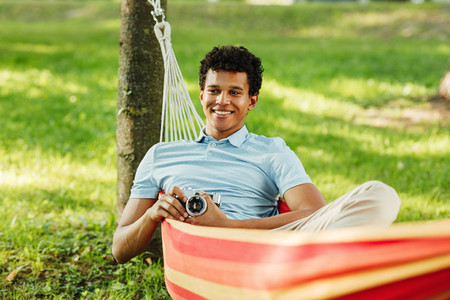 Young happy guy relaxing