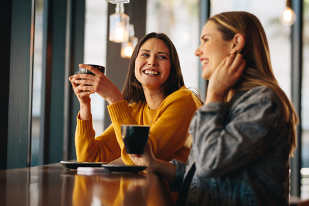 Friends meeting in coffee shop on a weekend