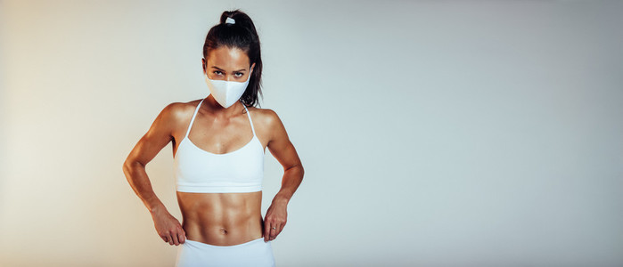 Sporty woman with protective face mask
