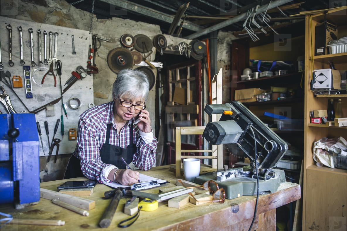 Female carpenter in her workshop