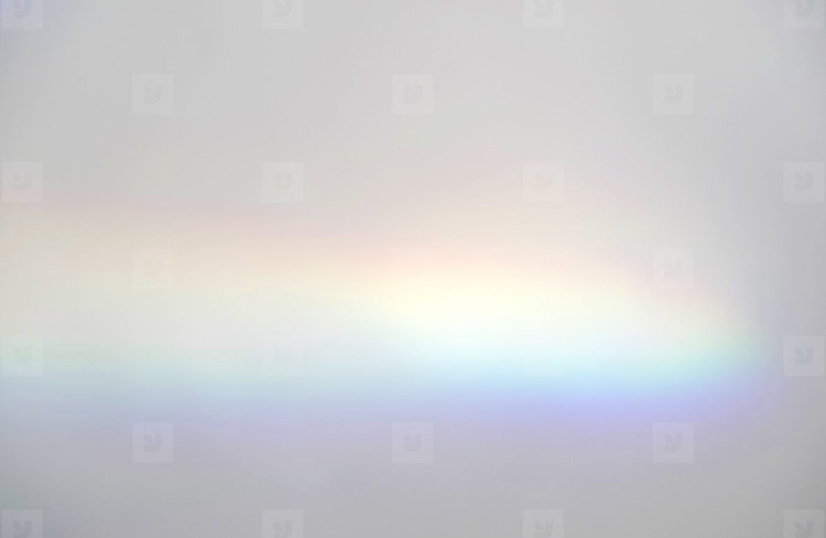 Abstract rainbow rays of light shadow overlay effect from sunlig