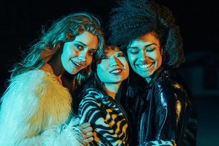 Close up of three happy girls