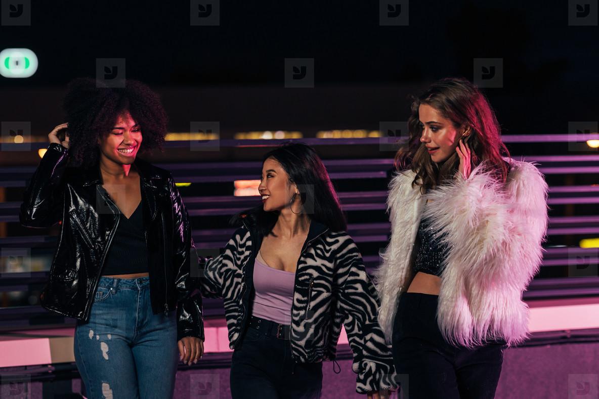 Three cheerful women walking