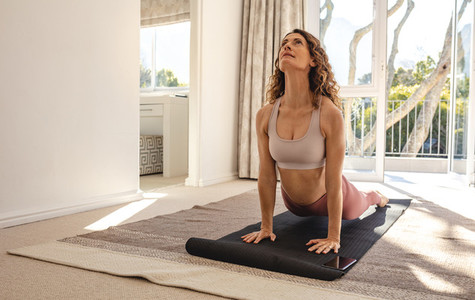 Woman doing yoga workout at home