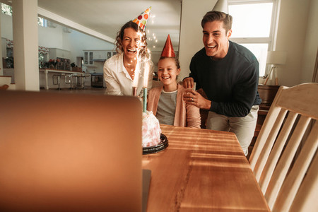 Family celebrating daughters birthday online