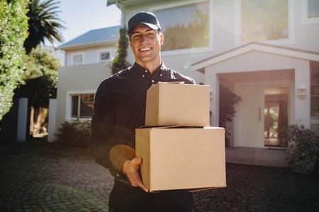 Courier worker delivering parcels