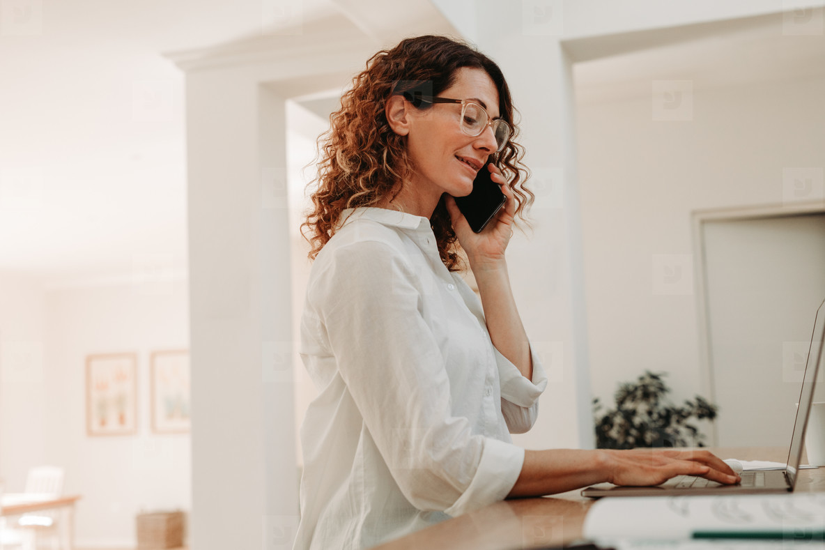 Businesswoman sitting at home and working