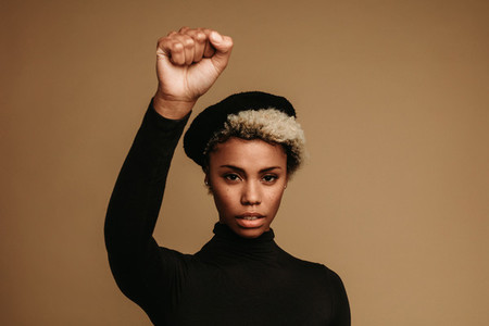 Close up of african american woman with raised fist