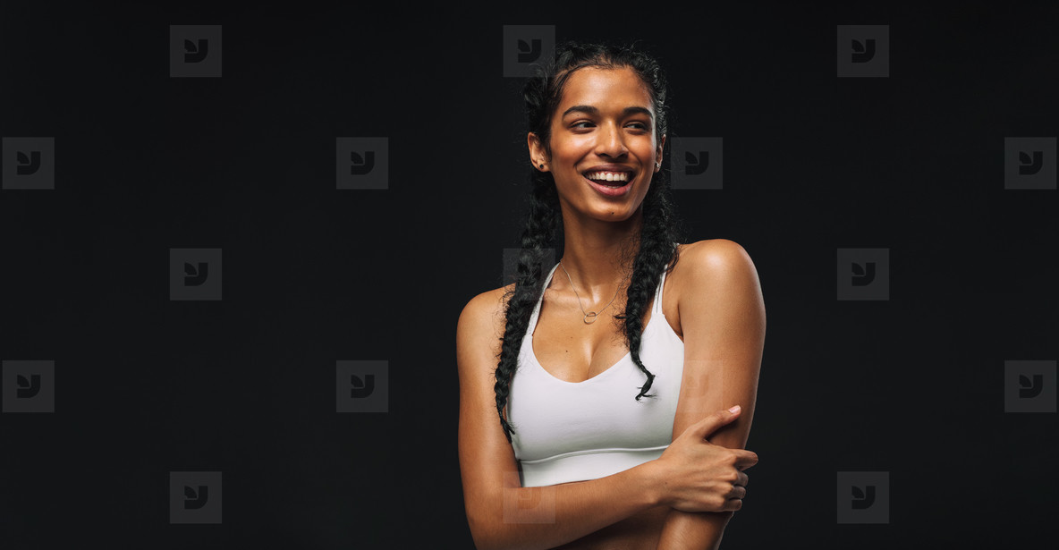 Female athlete on black background