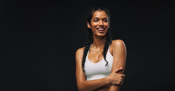 Female athlete on black background