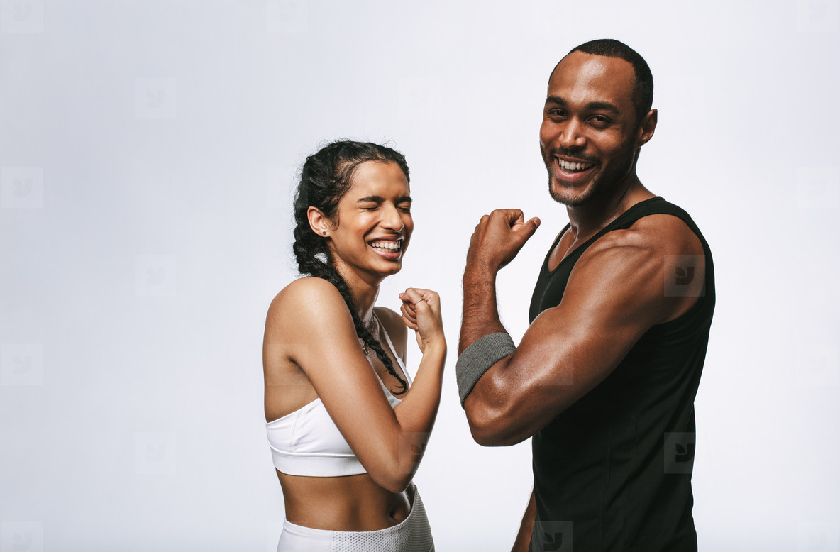 Portrait of laughing fitness couple