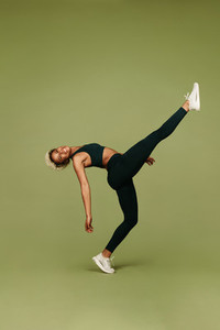 Athletic woman doing fitness exercises