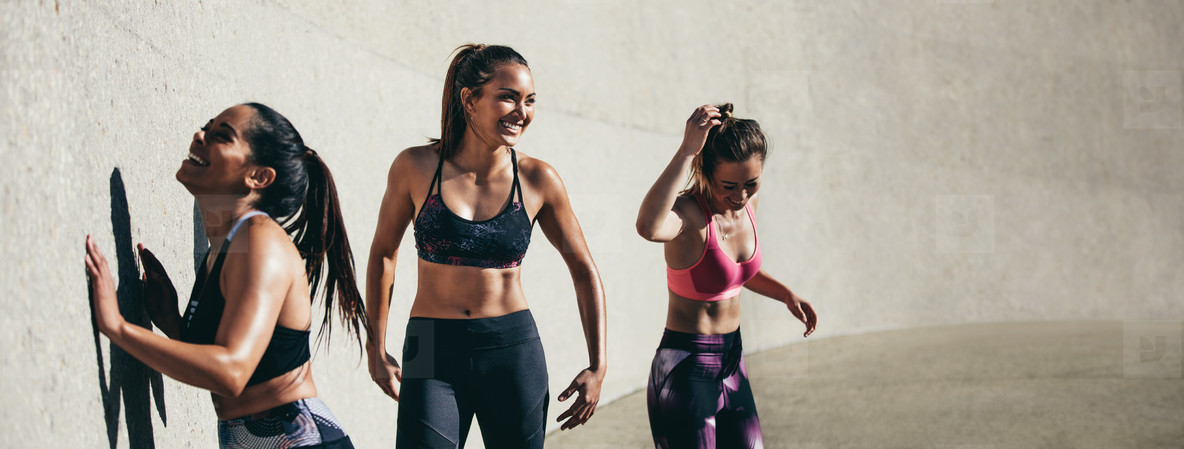 Female friends taking break after workout session