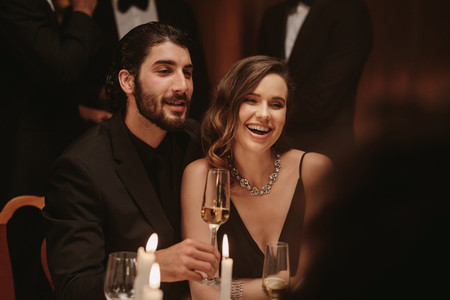 Beautiful couple at gala dinner party