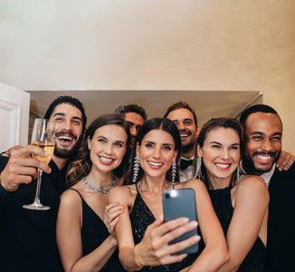 Multiracial group of socialites taking a selfie