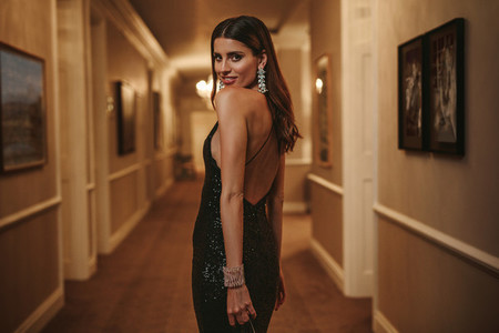 Stunning woman in corridor looking at camera