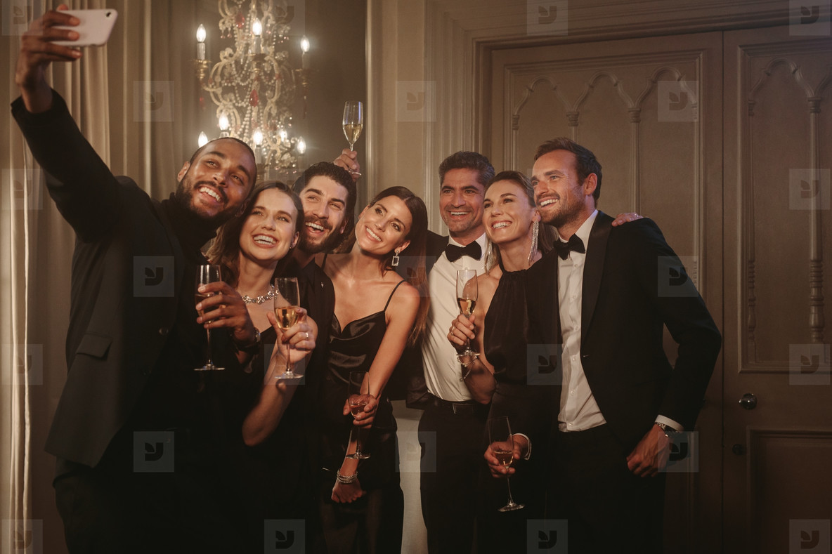 Man taking selfie with his friends at celebration party