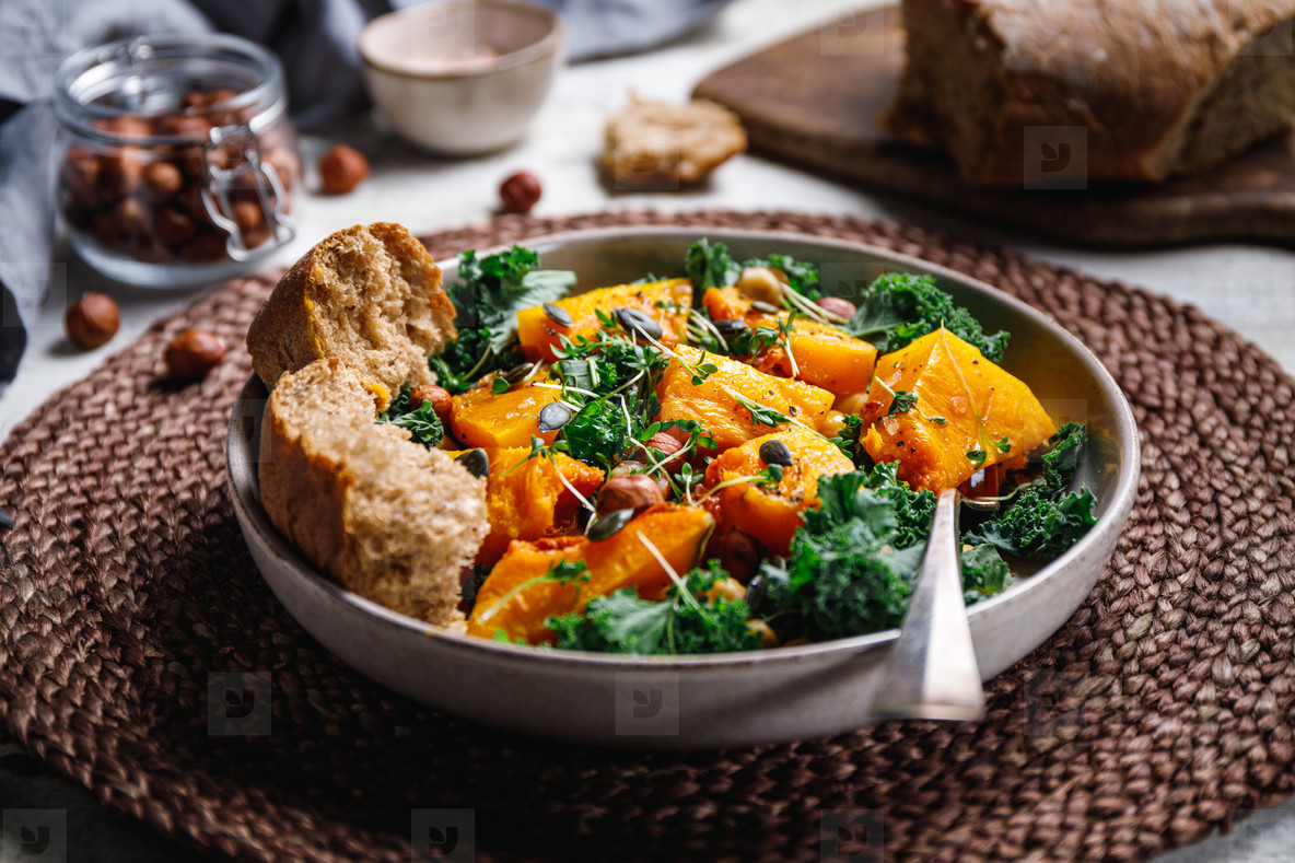 Season salad with grilled pumpkin  kale  chickpea  pepitas and nuts  Autumn vegetarian healthy recipe