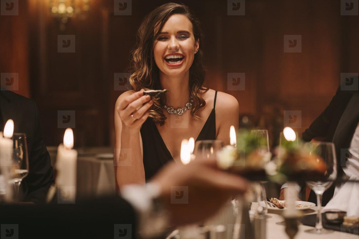 Beautiful woman enjoying at a gala dinner party