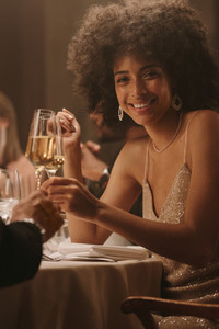 Smiling woman enjoying at a gala dinner event