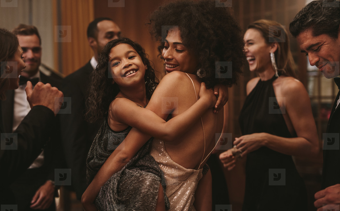 Girl dancing with her mother at a gala night event