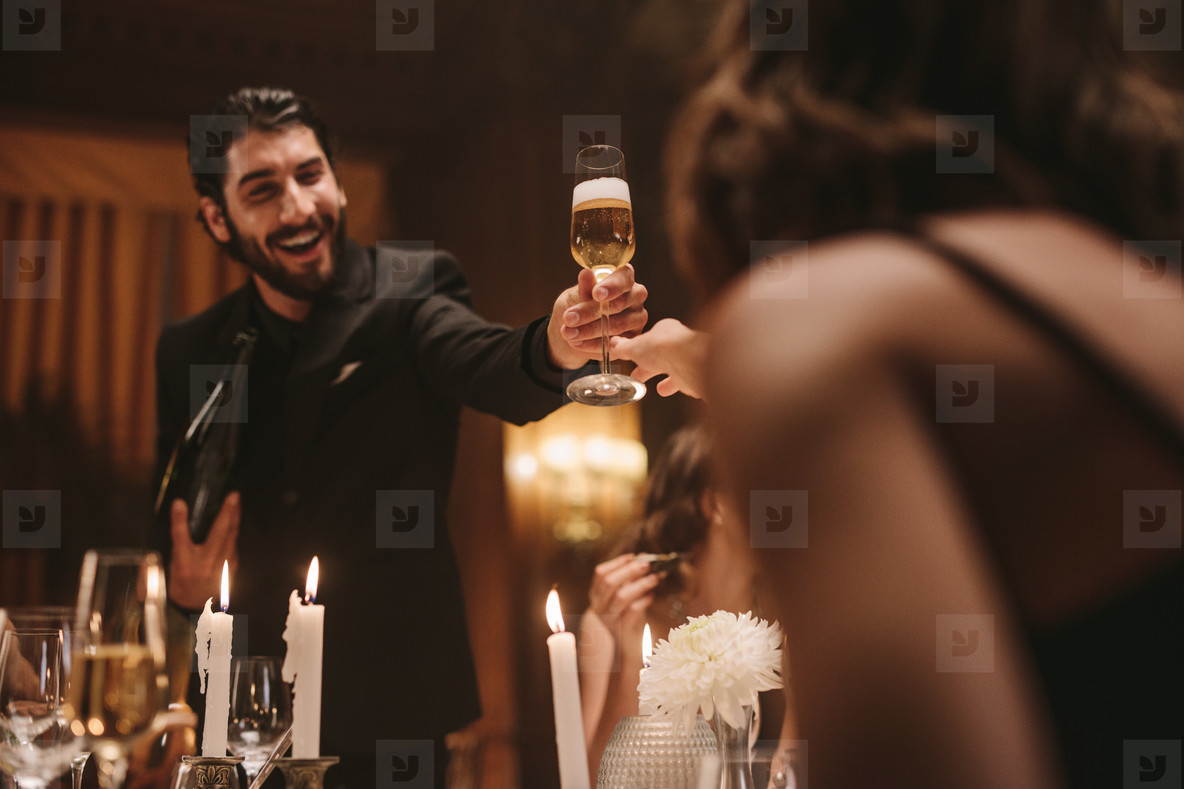 Friends having drinks at a dinner party