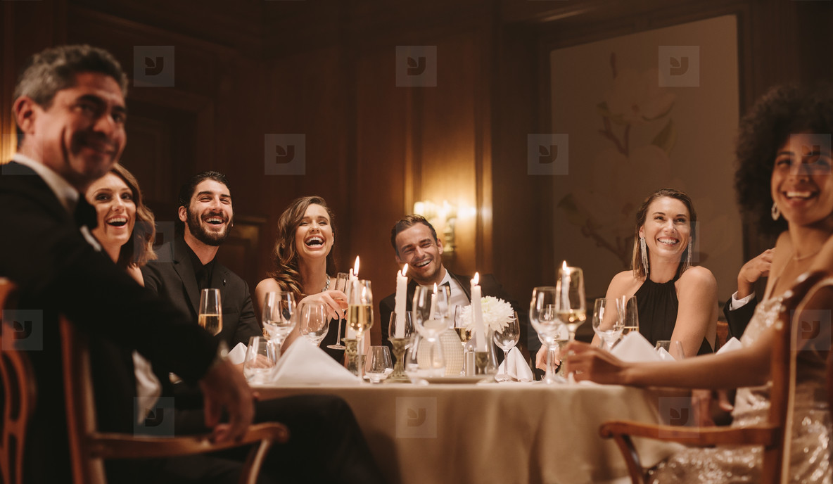 Group of people enjoying dinner party