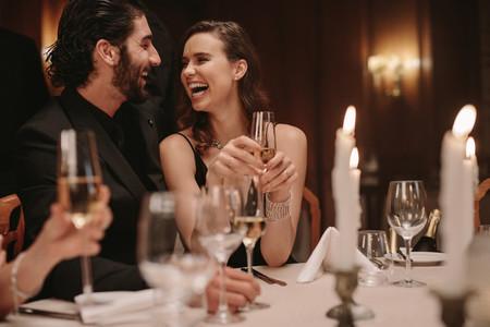 Cheerful couple at gala night dinner