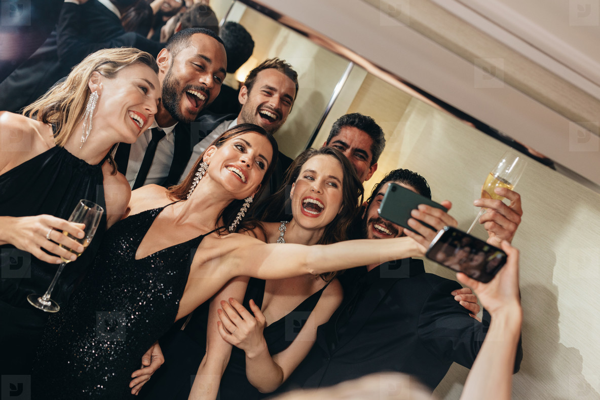 Socialites taking a selfie at party