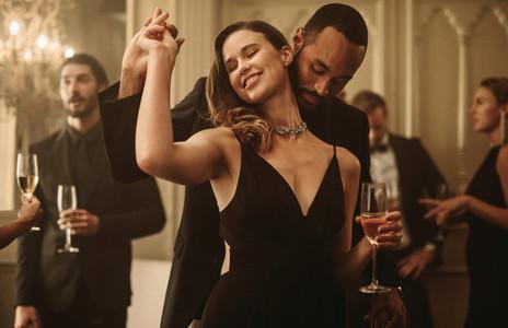Couple dancing at a gala night