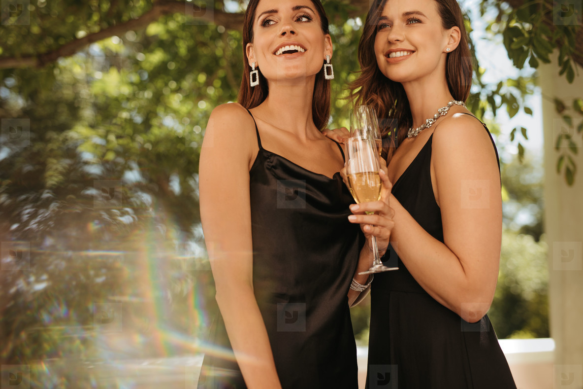 Beautiful women with champagne at a party