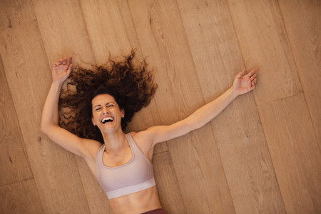 Smiling woman relaxing after workout at home