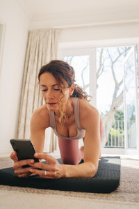 Woman using fitness app to workout