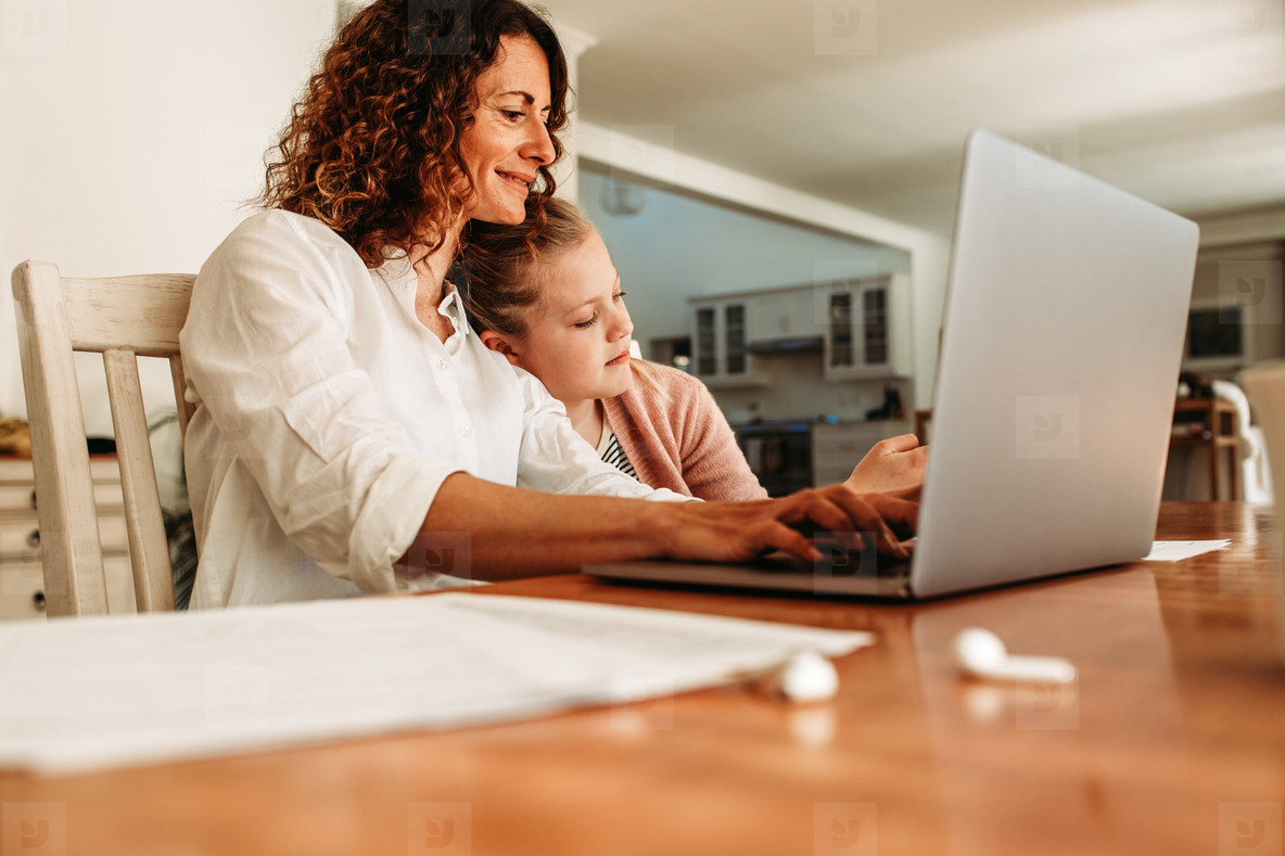Working mother doing her work at home