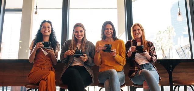 Ladies group enjoying coffee in cafe