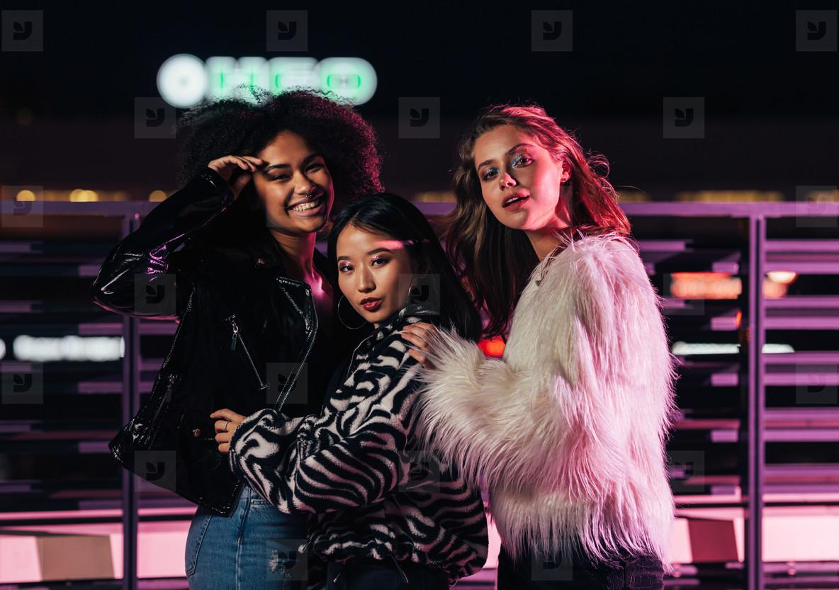 Three stylish girls standing