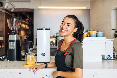 Smiling barista standing
