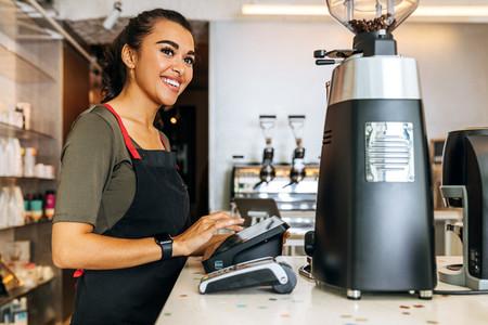 Female barista at counter