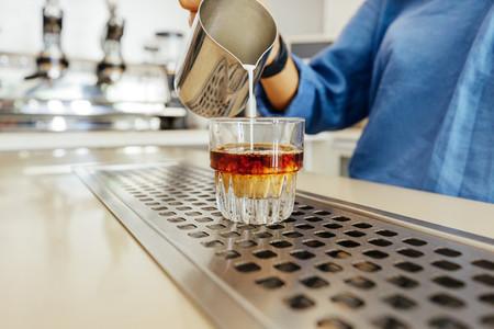 Unrecognizable barista pouring