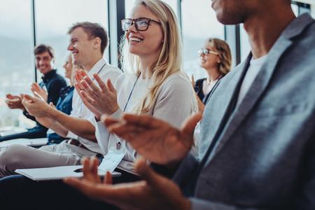 Business professionals applauding at a seminar