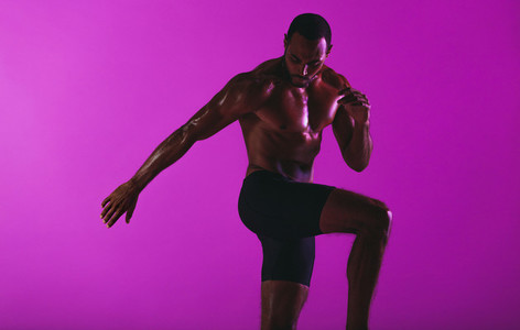 Muscular man doing fitness exercise