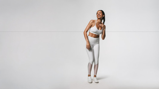 Smiling fit woman working out against white background