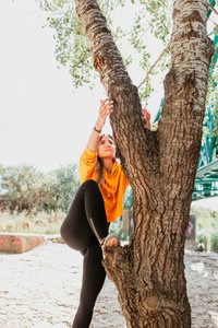 Woman enjoying climbing a tree  Freedom concept