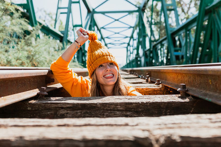 Woman has fun exploring an old  abandoned iron railroad bridge