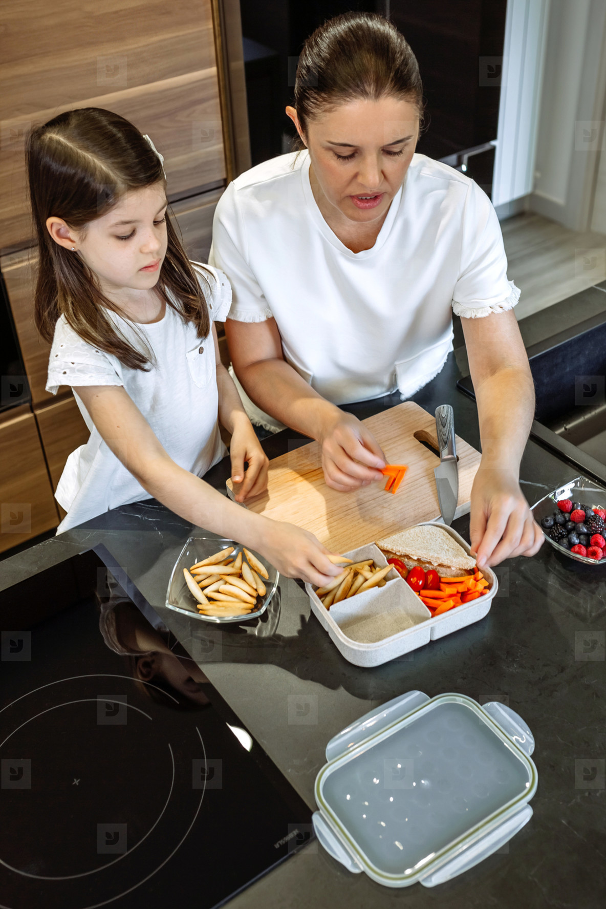 Mother and daughter preparing the lunch box for school