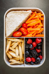 Top view of lunch box with healthy food