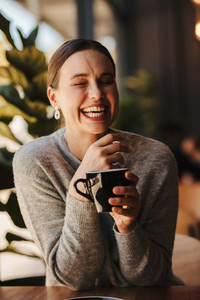 Pretty woman smiling at a coffee shop