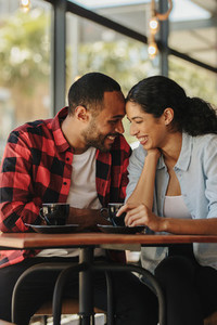 Loving couple having a great time at cafe